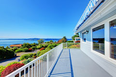 Porch with water view and grey house exterior. Stock Photo