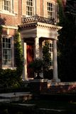 Porch with white columns. Porch of a big house with white columns royalty free stock photography