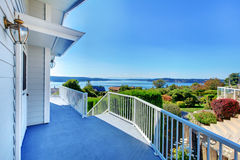 Porch With Water View And Grey House. Royalty Free Stock Images