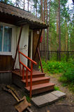 Porch wooden holiday houses in the pine forest Royalty Free Stock Images