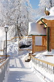 Porch of a wooden house. On a background of snowy trees Royalty Free Stock Photo