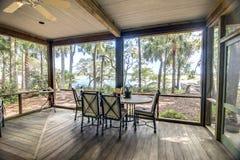 Porche rustique avec la vue de forêt et de bord de mer Photographie stock libre de droits