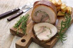 Porchetta, italienischer Schweinebraten Stockbild