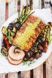 Porchetta met geroosterde groenten Stock Foto