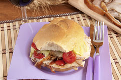 Porchetta sandwich with lettuce and tomatoes Stock Image