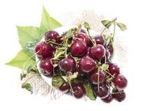 Porción de cerezas en blanco Foto de archivo libre de regalías