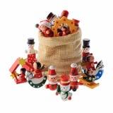 Porción de decoraciones multicoloras de la Navidad en un bolso de Santa Claus Imagen de archivo libre de regalías