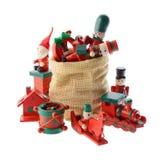 Porción de decoraciones multicoloras de la Navidad en un bolso de Santa Claus Fotografía de archivo libre de regalías