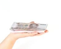 Porción de dinero a disposición aislada Fotografía de archivo libre de regalías