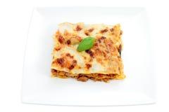 Porción de lasagna Imagen de archivo