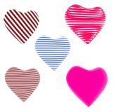 Porción de rojo, corazones rayados azules Imagenes de archivo