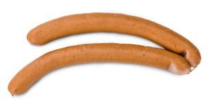 Porción de salchichas de la salchicha de Frankfurt aisladas en blanco Imagenes de archivo