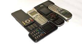 Porción de teléfonos móviles viejos fotos de archivo