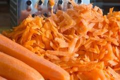 Porción de zanahorias en la tabla Fotos de archivo libres de regalías