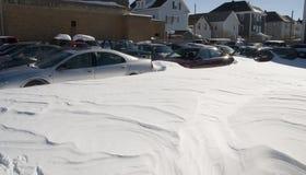 Porción del coche en nieve Imagen de archivo libre de regalías