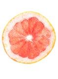 Porción roja del pomelo en el fondo blanco Imágenes de archivo libres de regalías