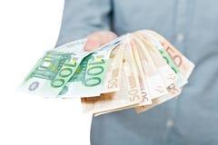 Porción de billetes de banco euro avivados a disposición Fotografía de archivo libre de regalías