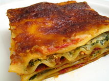 Porción del Lasagna de la espinaca Fotografía de archivo