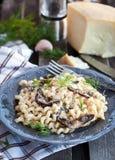 Porcini and parmesan pasta Stock Photos