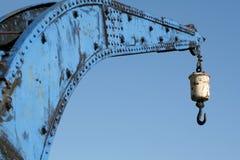 Porciones de azul y de un gancho de leva Foto de archivo libre de regalías
