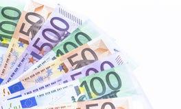 Porciones de billetes de banco euro del dinero aislados en blanco Fotos de archivo libres de regalías