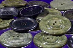 Porciones de botones grises y negros Imagen de archivo