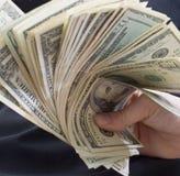 Porciones de dinero Imagen de archivo libre de regalías