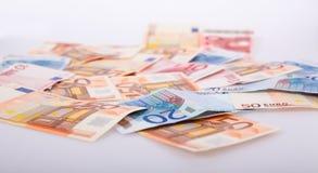 Porciones de dinero euro Imagenes de archivo