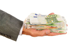 Porciones de dinero euro a disposición Fotos de archivo
