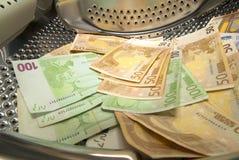 Porciones de lavar planchar de dinero euro Imagenes de archivo