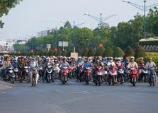 Porciones de motorbikers en la ciudad de Saigon Foto de archivo libre de regalías