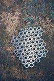 Porciones de nueces grises del metal Fotos de archivo