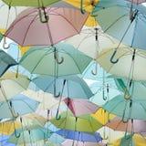 Porciones de paraguas coloreado pastel Imágenes de archivo libres de regalías