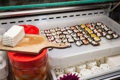 Porciones de queso cremoso en Golosaria 2013 en Milán, Italia Fotos de archivo libres de regalías
