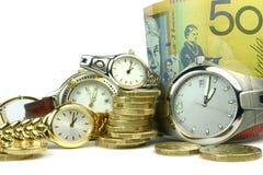 Porciones de tiempo y de dinero Imágenes de archivo libres de regalías