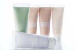 Porciones de tubos cosméticos imágenes de archivo libres de regalías