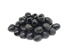 Porcja czarne oliwki, kopcująca przeciw Fotografia Stock