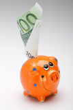 Porco alaranjado com dinheiro Imagens de Stock Royalty Free
