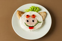 Porco alegre do arroz e das costoletas Imagem de Stock Royalty Free