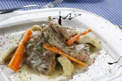 Porco e carote in salsa Fotografia Stock