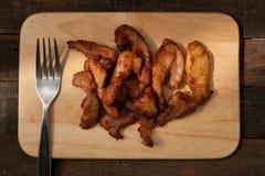 Porco fritto con aglio e pepe Fotografie Stock Libere da Diritti