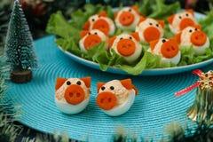 Porcos dos ovos enchidos 'para 2019 foto de stock royalty free
