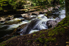 Porcupine Mountains State Park. The Presque Isle River carves it's way through rock as it flows towards Lake Superior. Porcupine Mountains State Park.  North Stock Photo