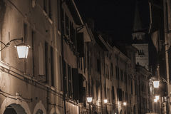 Pordenone inner city in the night. A view of the buildings of the central historical road of Pordenone Corso Vittorio Emanuele II during the night Royalty Free Stock Photos
