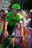 Pordenone, Italy May 27, 2017: Davide Formolo, Cannondale  team, transferring from the bus to the podium signatures. Before the start for a tough mountain stage Royalty Free Stock Photography