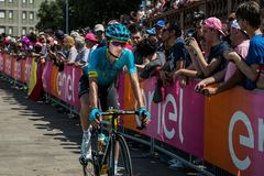 Pordenone, Italy May 27, 2017: Professional cyclist of the Astana Pro team, transferring from the bus to the podium signatures. Before the start for a tough Royalty Free Stock Photo