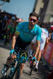 Pordenone, Italy May 27, 2017: Professional cyclist of the Astana Pro team, transferring from the bus to the podium signatures. Before the start for a tough Stock Images