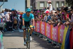 Pordenone, Italy May 27, 2017: Professional cyclist of the Astana Pro team, transferring from the bus to the podium signatures. Before the start for a tough Royalty Free Stock Images
