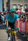 Pordenone, Italy May 27, 2017: Professional cyclist of the Astana Pro team, transferring from the bus to the podium signatures. Before the start for a tough Royalty Free Stock Photos