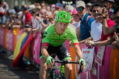 Pordenone, Italy May 27, 2017: Professional cyclist of the Cannondale team. Transferring from the bus to the podium signatures before the start for a tough Royalty Free Stock Image